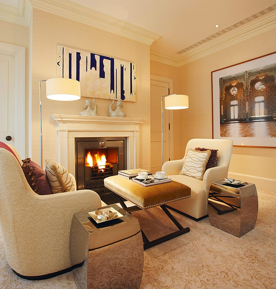 An open fire in the small living area helps the space become a private, cosy nook in which to unwind from the outside world. Standard lamps with 14inch shades provide the finishing touches to accompany late-night reading