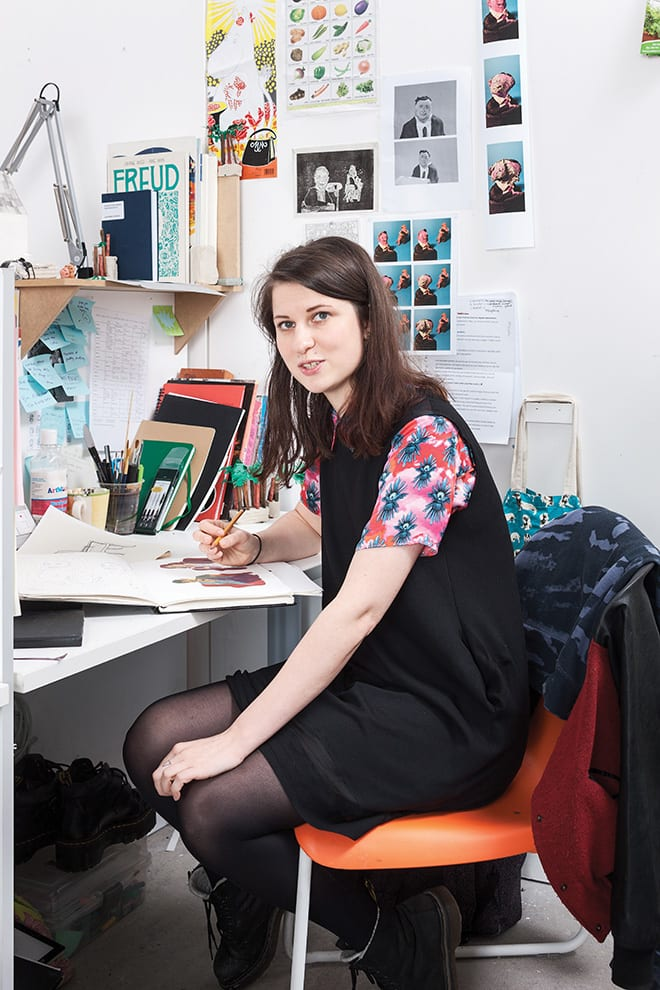 Illustrator Hannah Nixon at her desk in the Reid building at the Glasgow School of Art.