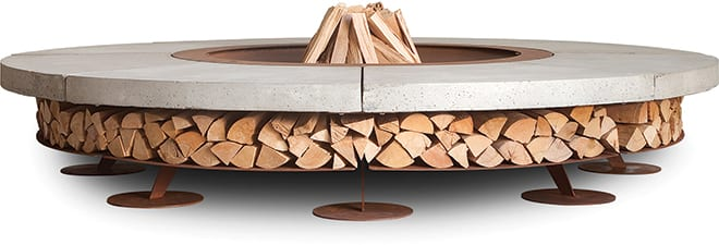 The Ercole fire pit provides storage for firewood