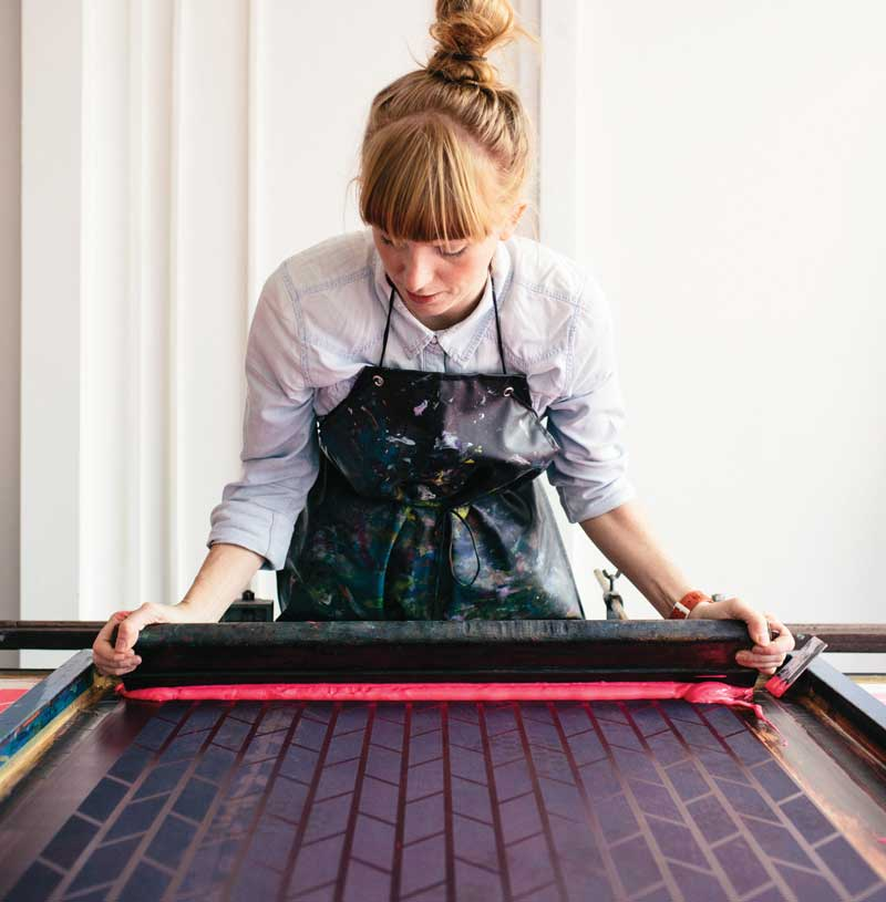 Textile designer Laura Spring works from her studio space at Glasgow's Grey Wolf Studios, where she creates new designs, as well as running classes for aspiring printmakers and hosting sales and exhibitions