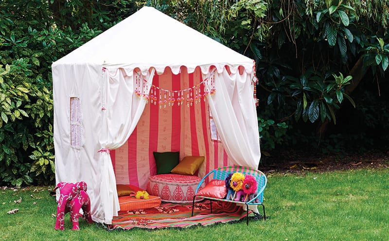 If you're looking for something less permanent than a solid structure, a luxury tent will do the job. Lined in pink stripes and complete with roll-down window blinds, this children's tent from Raj Tent Club is definitely more glamping than camping. £600.