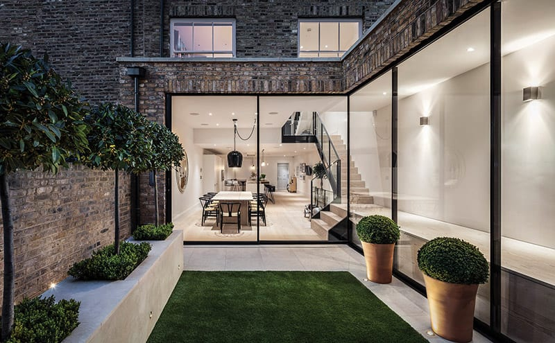 The rear of the house was extended during the renovations and massive glazed doors were added. Part of Cameron Interiors' brief was to make the most of all the extra natural light.