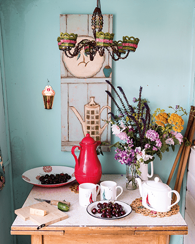 A still-life waiting to happen: flowers, crockery and fruit on Aunt Peg's table