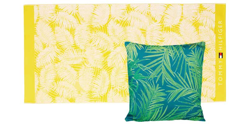 Palm Beach Towel in Sunny, £65, Tommy Hilfiger; Malini Palm Print Fabric Cushion, Blue and Green, £25, Cult Furniture
