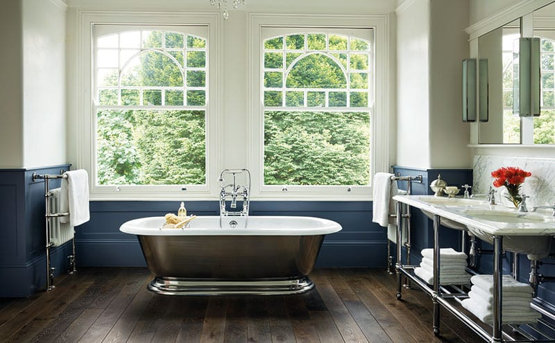 The classic white and chrome theme is extended to the shower and bath, with everything set off beautifully by the dark-blue panelling