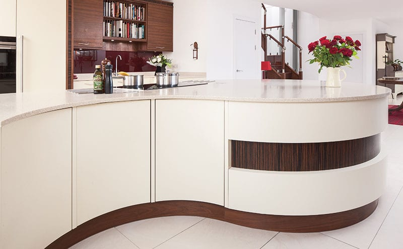 Part of the designer's task was to create distinct zones within the kitchen – a place for relaxing, a work station for food prep, a spot for mixing drinks and so on. The island's curves help this to look and feel natural