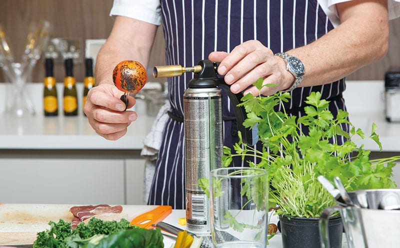Chef Nick Nairn preps a tomato for his melt-in-the-mouth dish