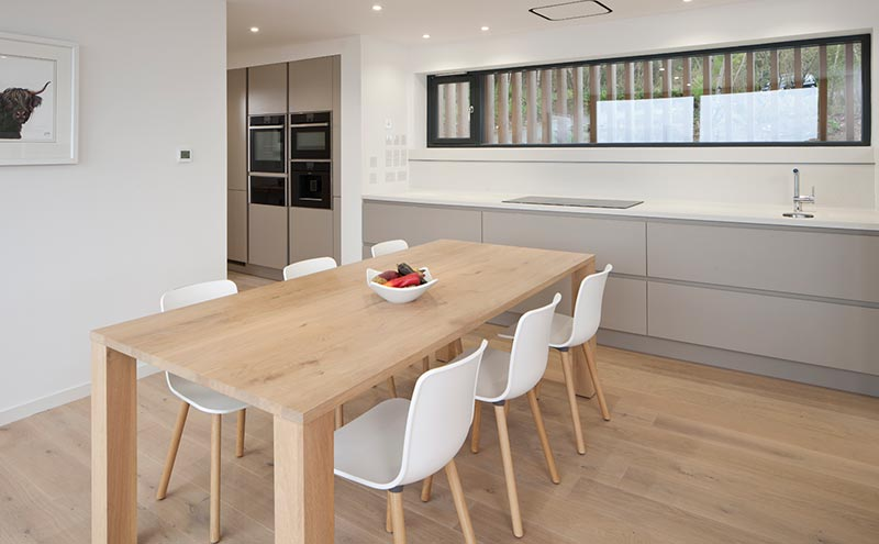 The kitchen, ProNorm by MiHaus, is simple and uncluttered