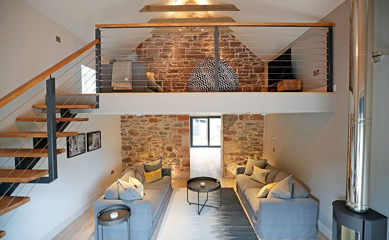 The mezzanine helps give it an open, airy feel, enhanced by the thin banisters and open treads of the staircase