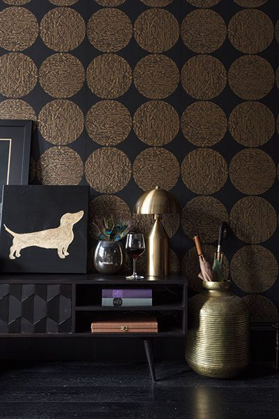 A close-up of Cole & Son's black and gold Luna wallpaper