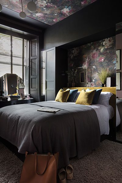The master bedroom epitomises Cathy Dean's rich, dark palette
