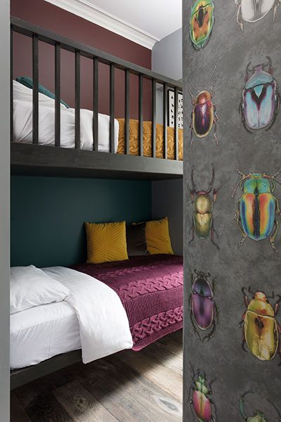 Woodchip & Magnolia's colourful Beetle wallpaper adds a fun note to the designer's daughter's bedroom. The bunks were made to order