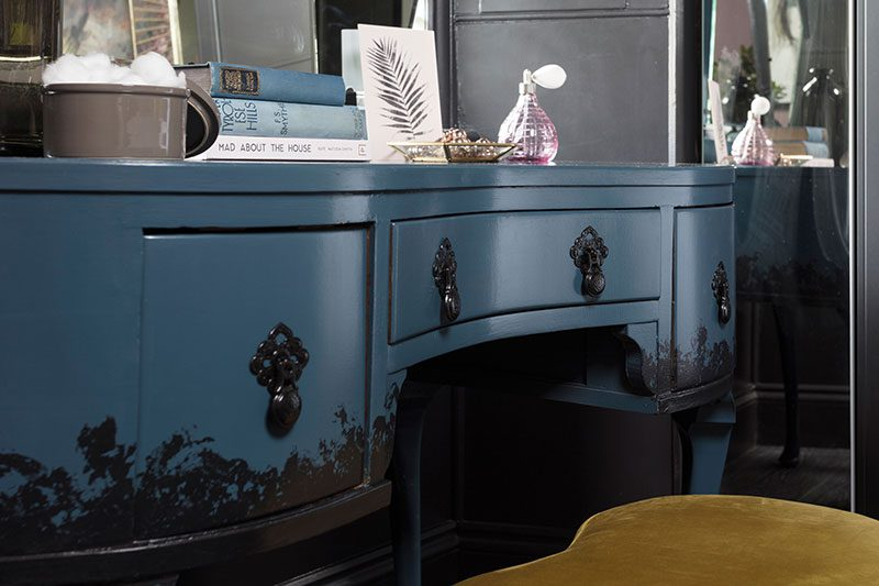 a close-up of the bespoke Done Up North dressing table in the master bedroom, which has black decoration added along its lower edge