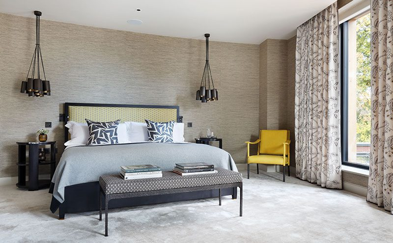 Earthy tones have been used in the principal guest suite, such as the Phillip Jeffries grasscloth on the walls