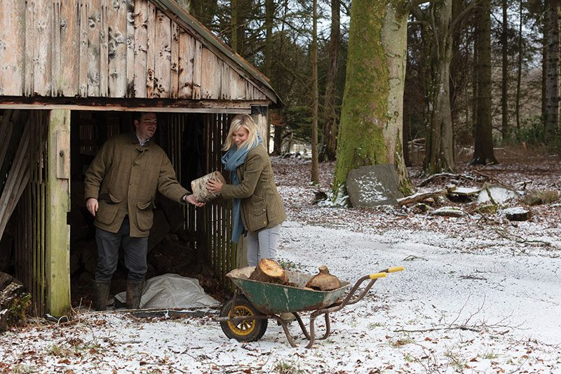 Chopping logs for the castle's many fireplaces is one way to keep warm on snowy days