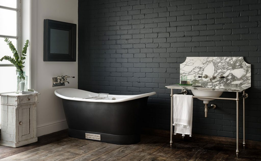 dark bathroom with marble sink by Catchpole & Rye