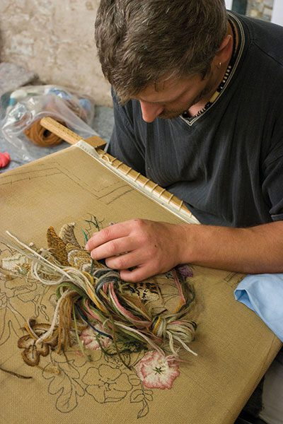 man-embroidering-a-floral-pattern