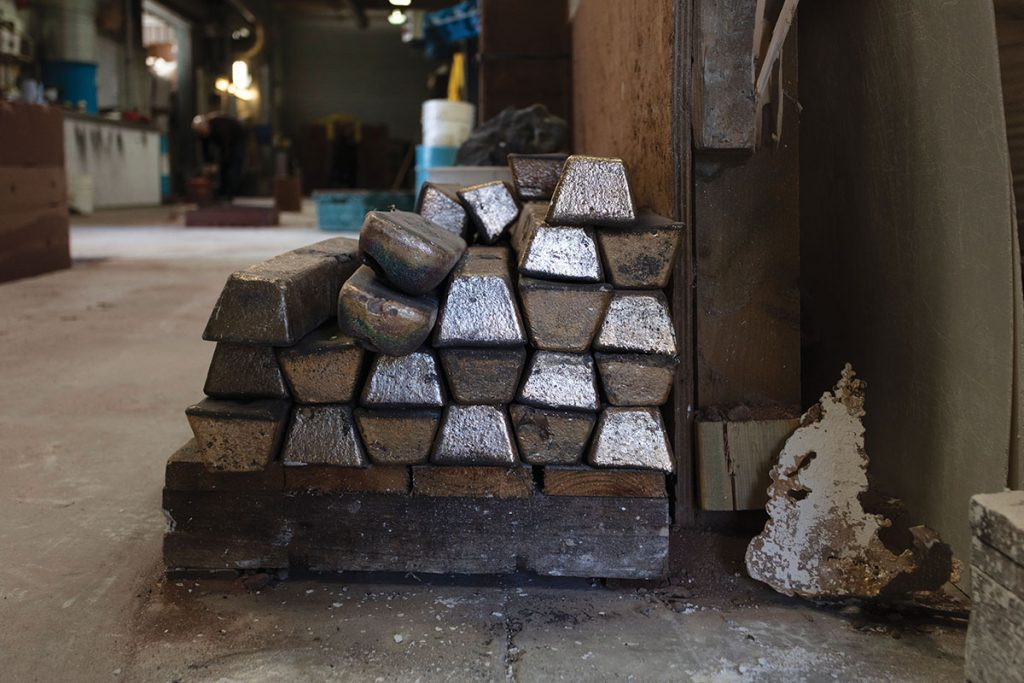 bronze-ingots-stacked-and-ready-to-be-transformed