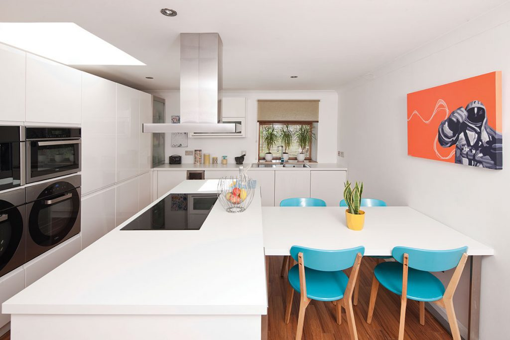 modern-kitchen-with-blue-chairs-and-orange-art-print