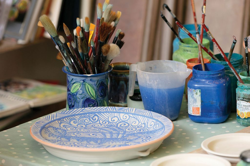painted-pottery-next-to-paintbrushes