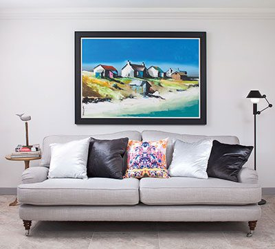 Nemo's Mr Light peeks out behind the Laura Ashley sofa and its Timorous Beasties cushions, next to a painting by Garry Brander