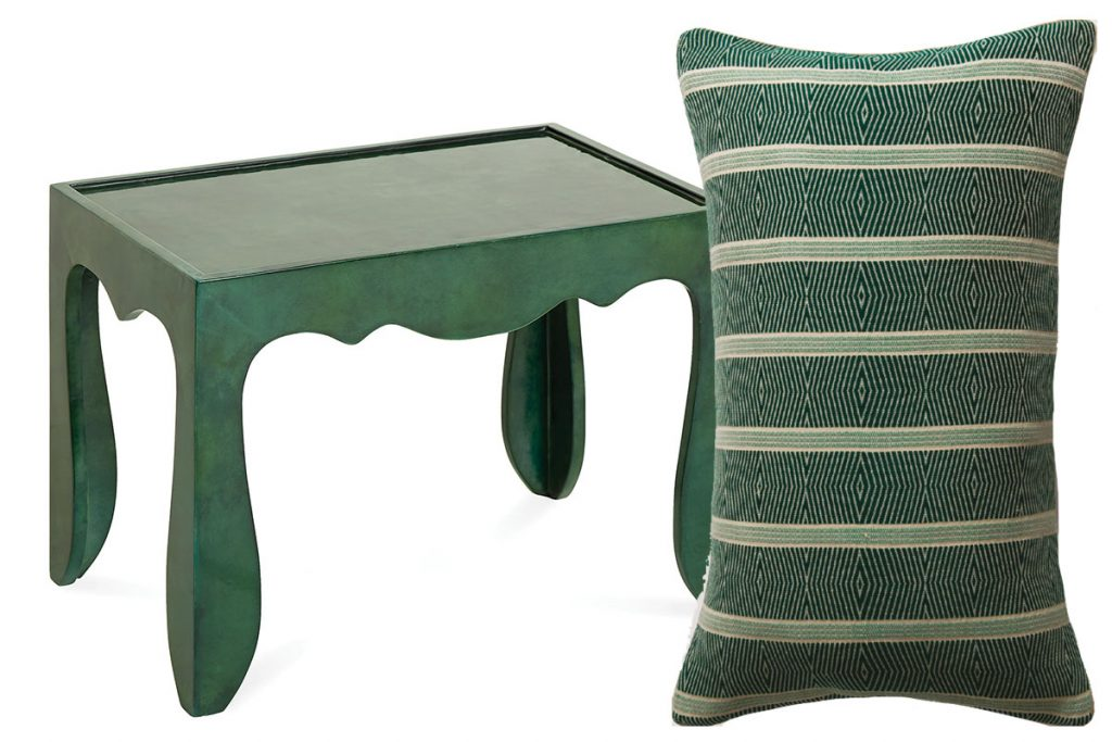 green-table-and-patterned-cushion