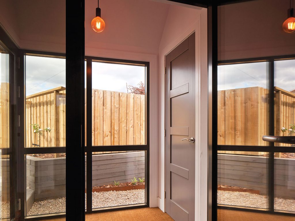 hall-with-glass-doors-and-exposed-bulb-lighting