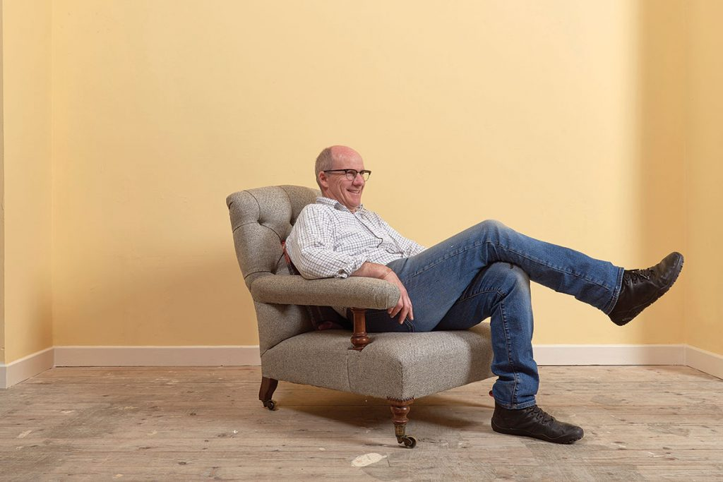 sitting-on-a-chair-in-a-yellow-room