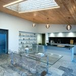 open-plan-kitchen-dining-room-with-glass-table