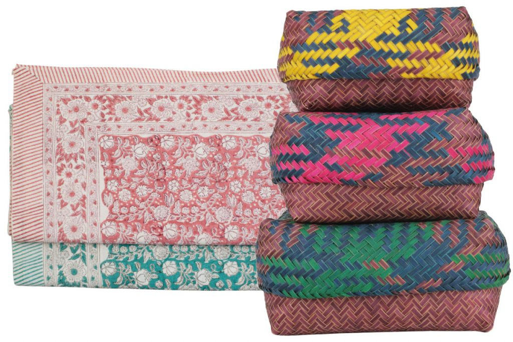 red-and-blue-blanket-and-green-pink-and-yellow-baskets