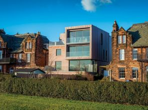 A gap between two traditional buildings in Edinburgh has been filled by this sharply modern home