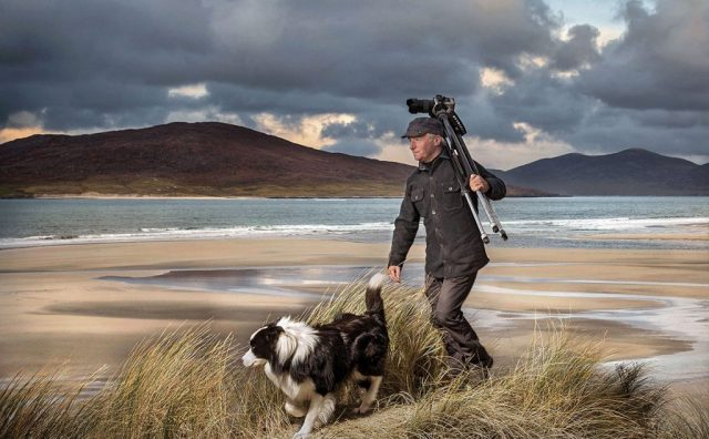 ian-lawson-walking-on-beach-in-the-hebrides-with-his-dog.jpg