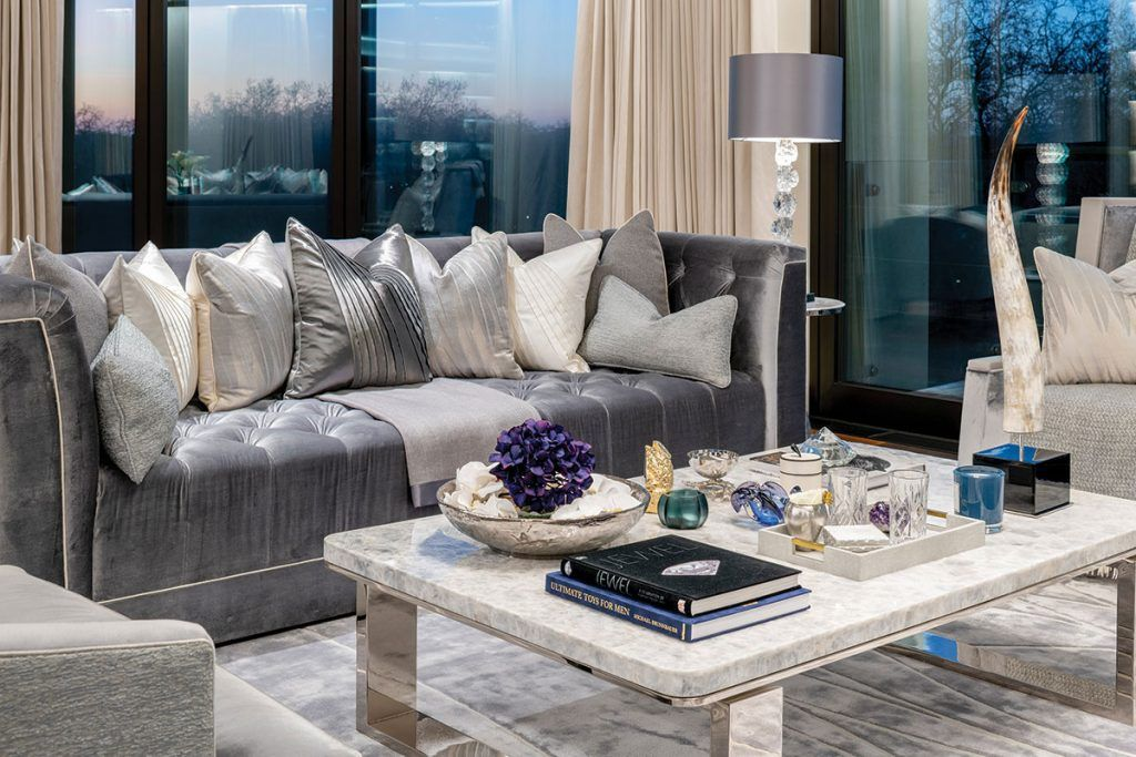 silver-sofa-and-marble-coffee-table-in-living-room.jpg