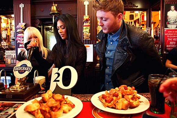 Cat that got the cask: Nicole Sherzinger and James Arthur pull a pint.