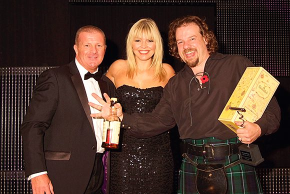 Jon Beach, right, celebrates his latest SLTN Award win with Kate Thornton and First Drinks' regional sales manager Gerry Mellor.