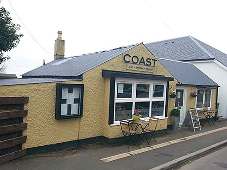• Coast is located next to the beach.