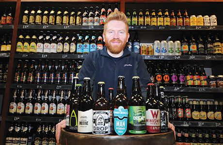 • Derek Hoy, who set up Hippo Beers with business partner Alec Knox, with some of the outlet's 350-strong range of UK and international brews.