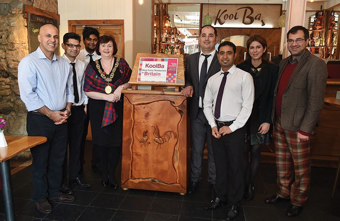 • Abdul Farrah (left) and the Koolba staff are presented with the Customers' Restaurant award