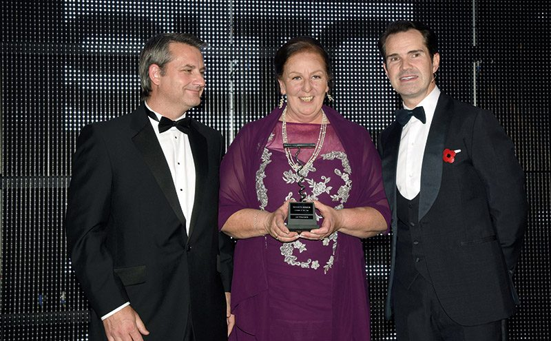 • SLTN Licensee of the Year Liz Ferguson collects her award.