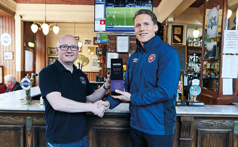 Kevin McGhee receives his trophy from Hearts' Christophe Berra