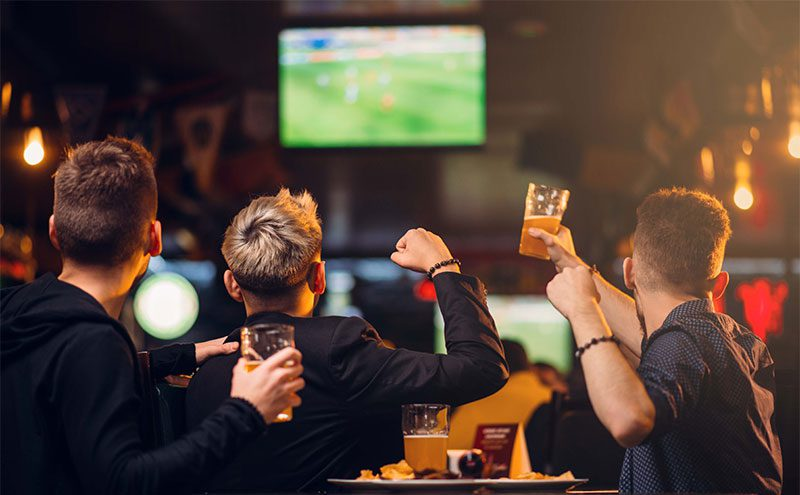Men watching sport on a pub TV
