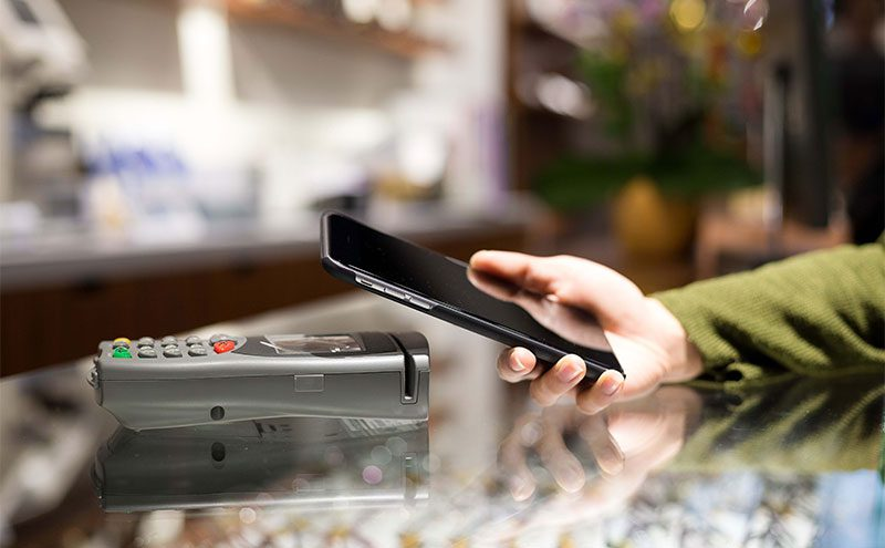 Customer paying with their mobile phone
