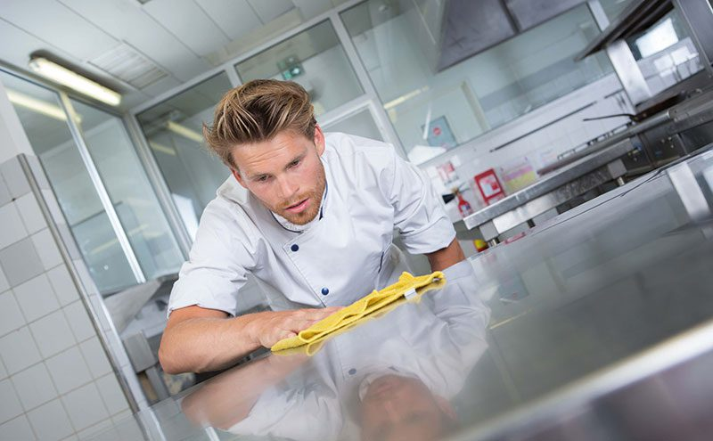 chef cleaning kitchen