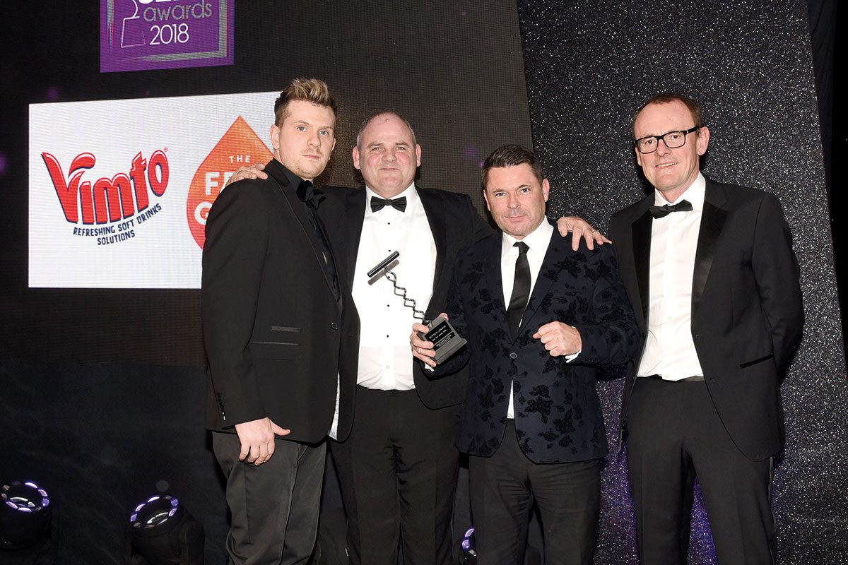 Richard Fergie collects the SLTN Award for Best Soft Drinks Offer