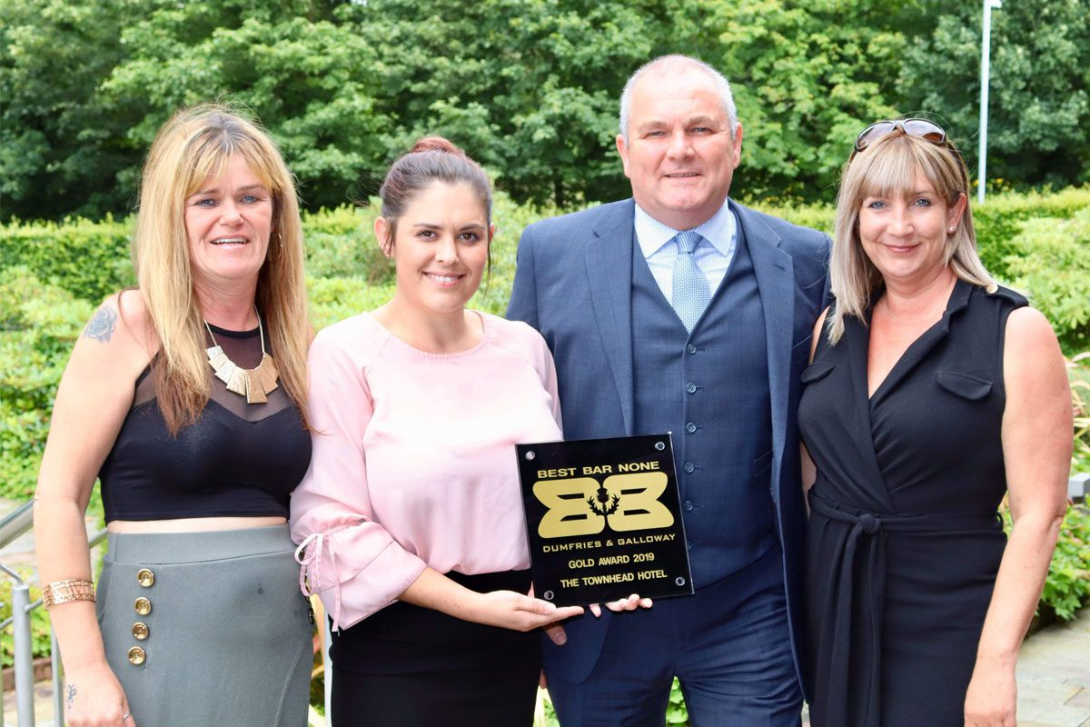 Townhead Hotel owners with Best Bar None gold award