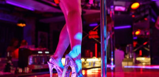pair-of-legs-on-stage-with-pole