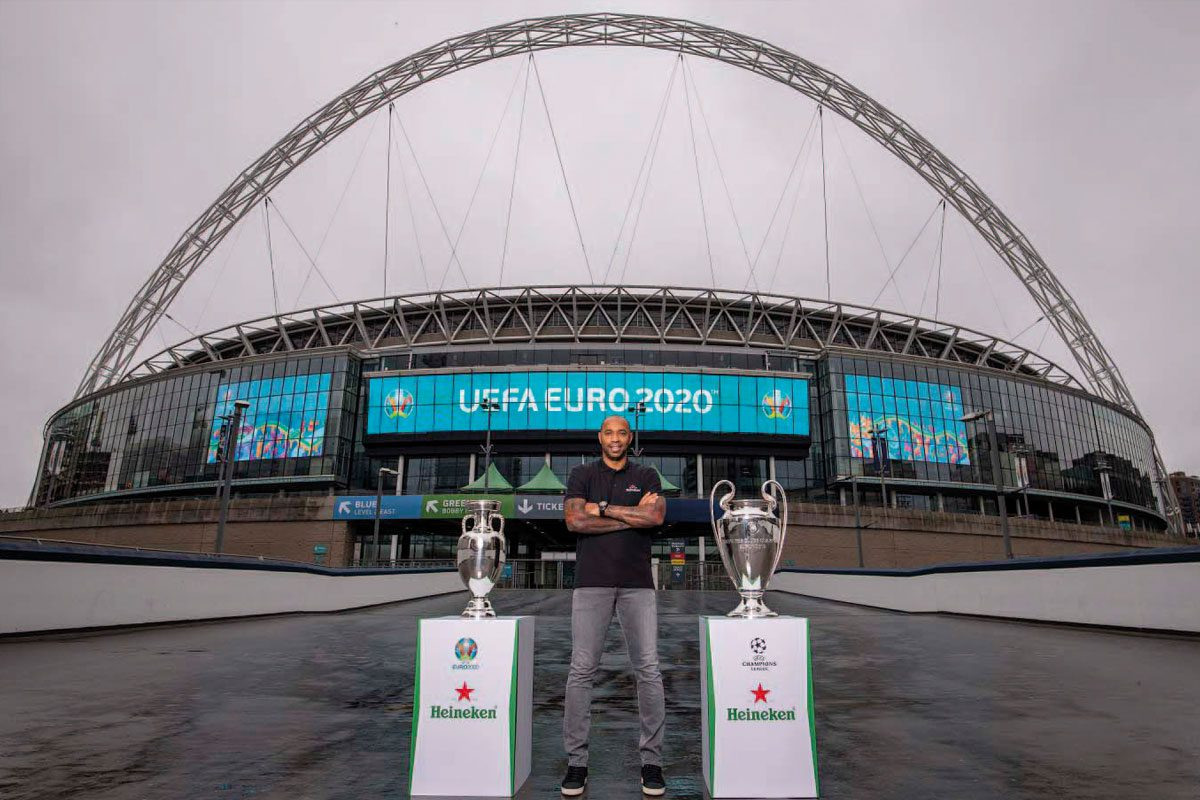 Thiery Henry with UEFA trophies