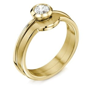 Contemporary solitaire brilliant-cut diamond engagement ring, £1699, and matching wedding band in 9ct yellow gold, £270, Sheila Fleet