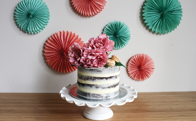 Lily McLeod's chocolate and salted caramel semi-naked cake has four layers and is presented with peonies and salted caramel macarons