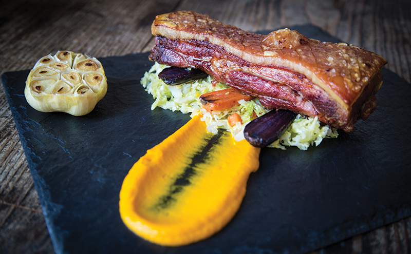 Roasted pork belly with savoy cabbage and glazed carrots (bespoke-catering.com)
